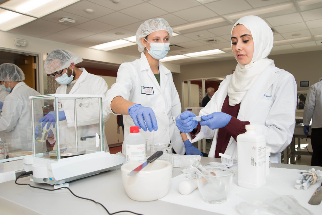 Students in lab with white coats