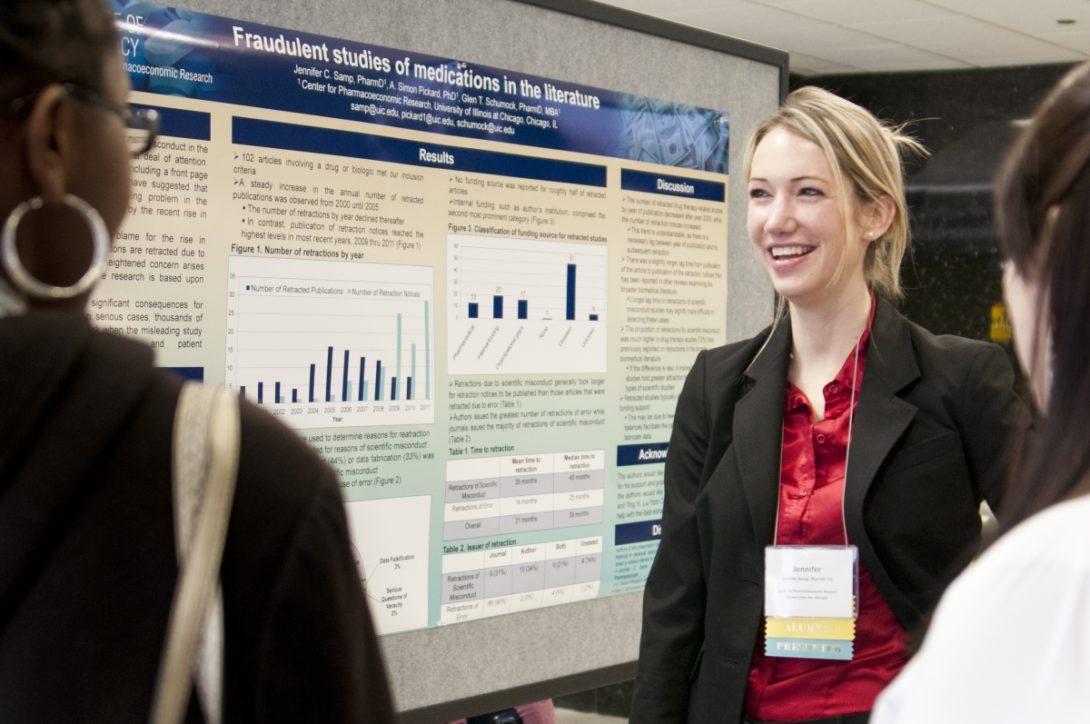 Graduate student presenting poster